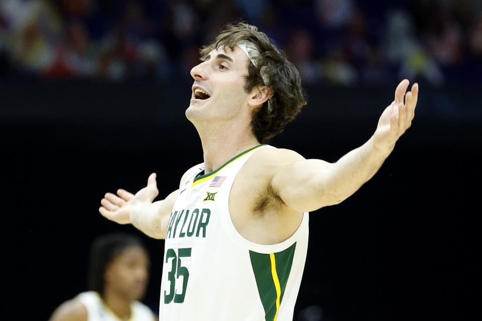 INDIANAPOLIS, INDIANA - APRIL 03: Mark Paterson #35 of the Baylor Bears celebrates in the final seconds prior to defeating the Houston Cougars 78-59 in the 2021 NCAA Final Four semifinal to advance to the National Championship game at Lucas Oil Stadium on April 03, 2021 in Indianapolis, Indiana. (Photo by Tim Nwachukwu/Getty Images)