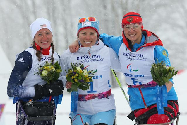 SOCHI, RUSSIA - MARCH 12: Silver medalist Tatyana McFadden of the United States, gold medalist Mariann Marthisen of Norway and bronze medalist Marta Zaynullina of Russia pose at the flower ceremony for the women's 1km sprint, sitting cross-country during day five of Sochi 2014 Paralympic Winter Games at Laura Cross-country Ski & Biathlon Center on March 12, 2014 in Sochi, Russia. (Photo by Mark Kolbe/Getty Images)