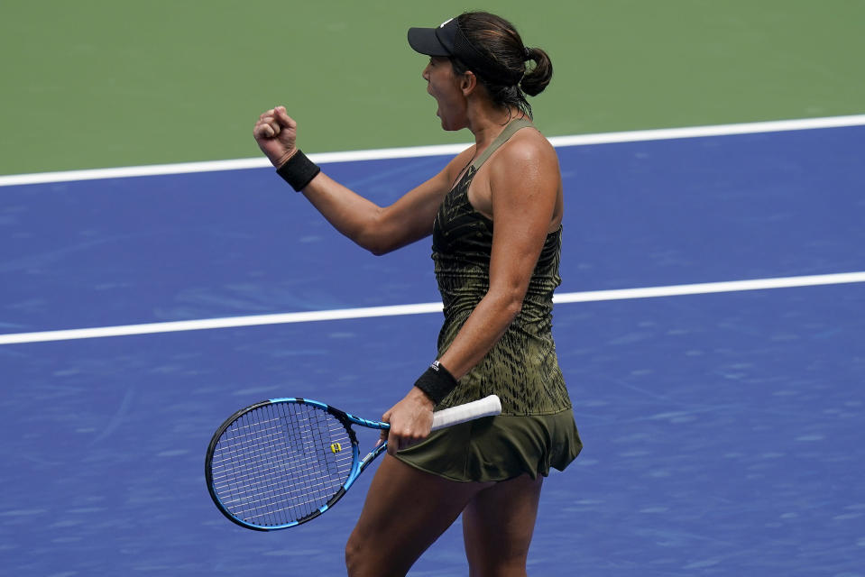 Garbine Muguruza, of Spain, reacts after a point against Donna Vekic, of Croatia, during the first round of the US Open tennis championships, Monday, Aug. 30, 2021, in New York. (AP Photo/Seth Wenig)