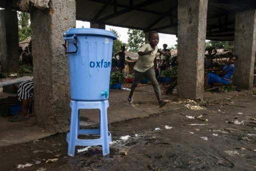 Dispensers containing water mixed with disinfectant are being used in Mbandaka during the Ebola outbreak