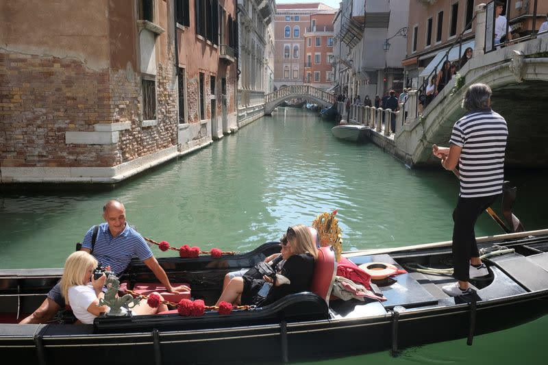 Tourists visit Venice as the municipality prepares to charge them up to 10 Euro for entry into the lagoon city, in Venice