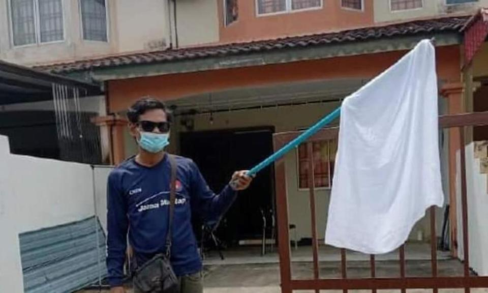 After raising white flag, father of two gets help for food, rent