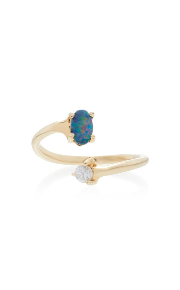 """<p>This ring gives you the best of both worlds with a diamond on one end and an opal on the other. In addition to the unique stones, the wrap-around design also makes this ring feel special.</p><p>Buy it <a rel=""""nofollow"""" href=""""https://click.linksynergy.com/fs-bin/click?id=93xLBvPhAeE&subid=0&offerid=559280.1&type=10&tmpid=9894&RD_PARM1=https%3A%2F%2Fwww.modaoperandi.com%2Feden-presley-ss17%2F14k-gold-boulder-opal-and-diamond-ring%3F%2B&u1=IS%2C10OpalEngagementRingsThatWillMakeYouForgetAllAboutDiamonds%2Cezajdman1271%2CFAS%2CGAL%2C3387898%2C201812%2CT"""">here</a> for $360.</p>"""