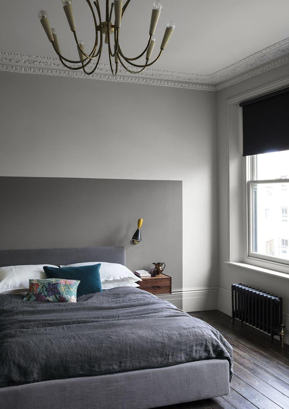 """<p>A great way to zone a space and create a faux headboard is with paint. To recreate this clever yet simple grey bedroom idea, simply mark out where the bed is going to go and outline with a pencil where you want the 'headboard' to be. Use masking tape to keep the paint from blurring, and just paint in the square. Continue the line down onto the skirting board for a designer finish.</p><p>Top Tip: To build up a tonal grey bedroom scheme, choose a paler grey on the rest of the walls.</p><p>Pictured: Ceiling: Slate II, Walls: Slate IV, Headboard: Sharkskin, all Pure Matt Emulsion, £51 for 2.5 ltrs, <a href=""""https://www.paintandpaperlibrary.com/"""" rel=""""nofollow noopener"""" target=""""_blank"""" data-ylk=""""slk:Paint & Paper Library"""" class=""""link rapid-noclick-resp"""">Paint & Paper Library</a></p>"""