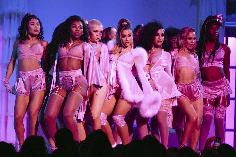 Ariana Grande, center, performs a medley at the 62nd annual Grammy Awards on Sunday, Jan. 26, 2020, in Los Angeles. (Photo by Matt Sayles/Invision/AP)