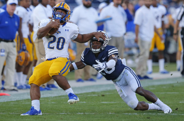 BYU defensive back Michael Shelton (18) tackles McNeese State running back Justin Pratt (20) in the second half during an NCAA college football game Saturday, Sept. 22, 2018, in Provo, Utah. (AP Photo/Rick Bowmer)