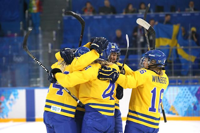 SOCHI, RUSSIA - FEBRUARY 09: Jenni Asserholt #4 of Sweden celebrates socring the first goal with her teammates during the Women's Ice Hockey Preliminary Round Group B Game on day two of the Sochi 2014 Winter Olympics at Shayba Arena on February 9, 2014 in Sochi, Russia. (Photo by Bruce Bennett/Getty Images)