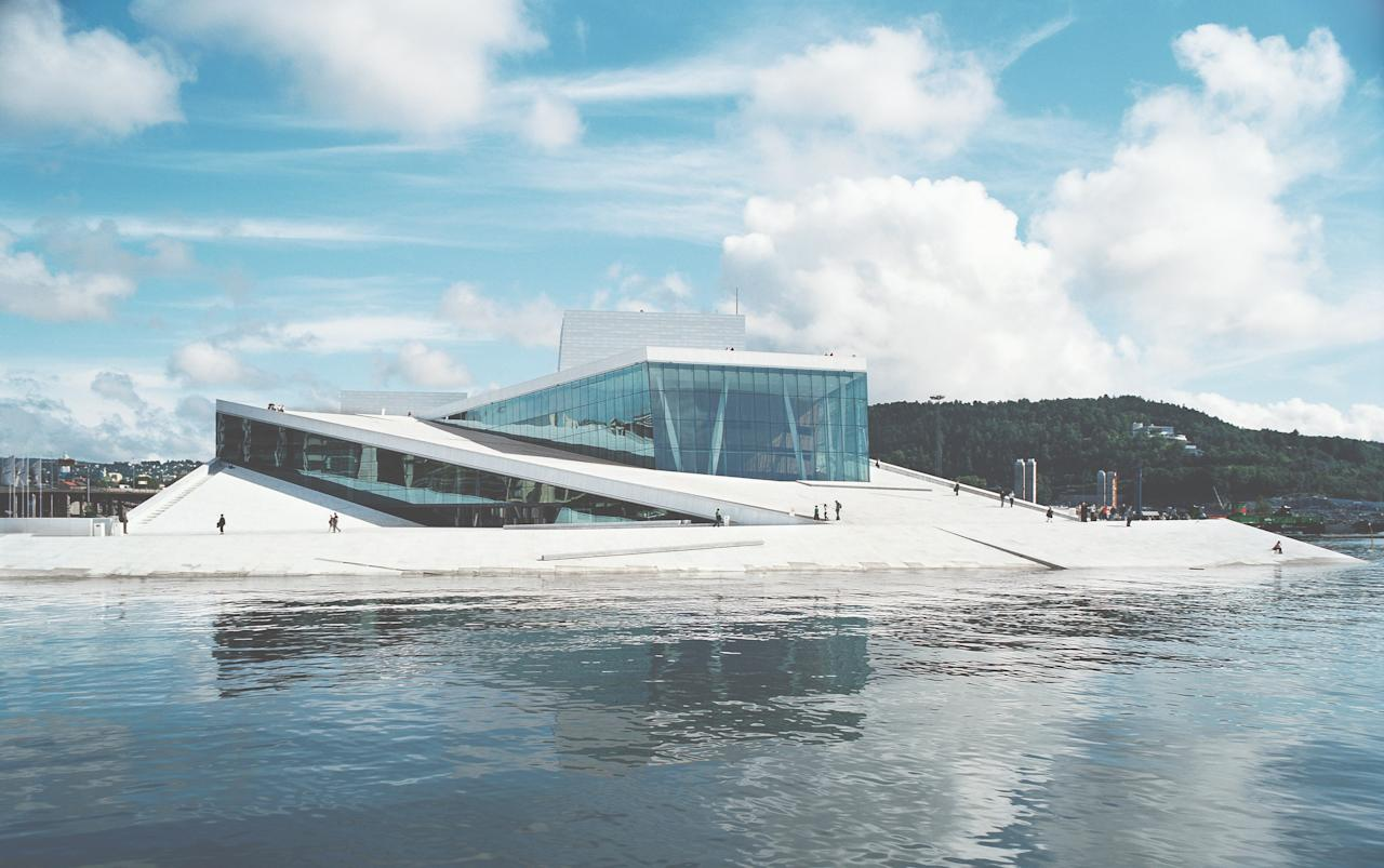 The <strong>Norwegian National Opera and Ballet</strong> was designed to be a democratic structure, where visitors—whether they hold a ticket or not—can explore the Carrara marble–clad roof plaza and lobby. Completed in 2008, the building has become the jewel of the Oslo waterfront district and spurred more development, helping to revive the area.