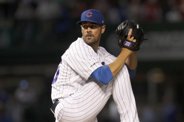 Chicago Cubs starting pitcher Cole Hamels winds up during the first inning of a baseball game against the Cincinnati Reds, Monday, Sept. 16, 2019, in Chicago. (AP Photo/Charles Rex Arbogast)