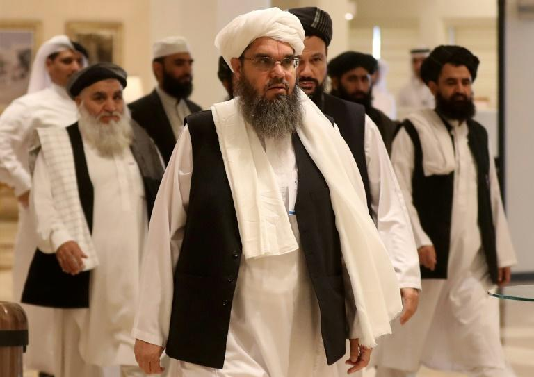 The Taliban's former envoy to Saudi Arabia Shahabuddin Delawar (C) arrives with other Taliban members to attend the Intra Afghan Dialogue talks in the Qatari capital Doha on July 7, 2019