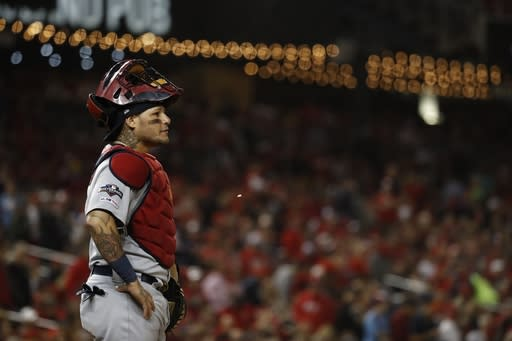 St. Louis Cardinals catcher Yadier Molina pauses during the second inning of Game 4 of the baseball National League Championship Series against the Washington Nationals Tuesday, Oct. 15, 2019, in Washington. (AP Photo/Jeff Roberson)
