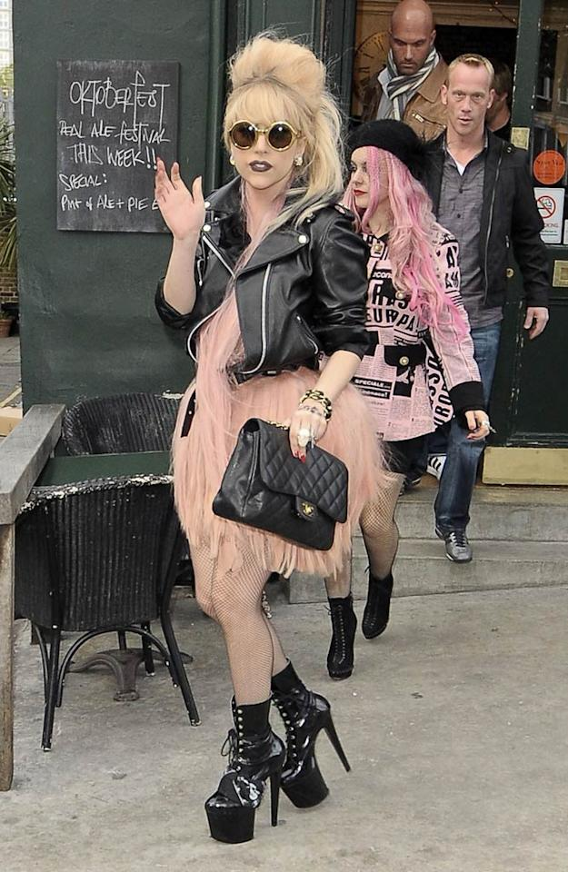 "Sporting one of her usual fabulously eccentric outfits, Lady Gaga was spotted leaving The Westbourne in London Thursday. While she was inside sampling the pub fare, the ""Paparazzi"" singer took pity on the photogs outside, and sent out milk and cookies for them to snack on while they waited! Perry Smylie/<a href=""http://www.infdaily.com"" target=""new"">INFDaily.com</a> - October 21, 2010"