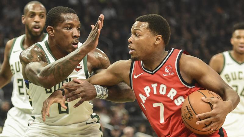 Nov 2, 2019; Milwaukee, WI, USA; Toronto Raptors guard Kyle Lowry (7) drives for the basket against Milwaukee Bucks guard Eric Bledsoe (6) in the first quarter at Fiserv Forum. Mandatory Credit: Benny Sieu-USA TODAY Sports