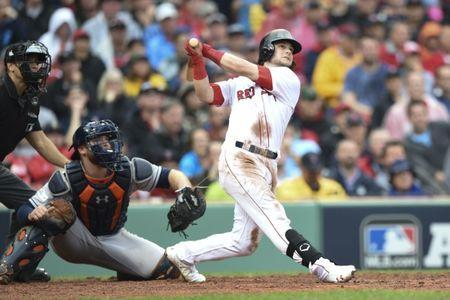 Oct 9, 2017; Boston, MA, USA; Boston Red Sox left fielder Andrew Benintendi (right) hits a two-run home run against Houston Astros catcher Brian McCann (left) during the fifth inning in game four of the 2017 ALDS playoff baseball series at Fenway Park. Mandatory Credit: Bob DeChiara-USA TODAY Sports