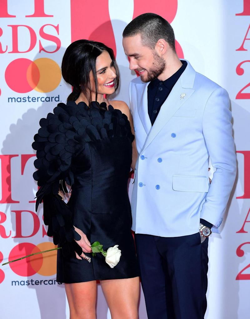Loved up: Cheryl and Liam Payne on the red carpet (PA)