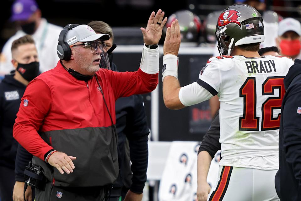 Head coach Bruce Arians and Tom Brady #12 of the Tampa Bay Buccaneers celebrate after scoring a touchdown in the second quarter against the Las Vegas Raiders at Allegiant Stadium on October 25, 2020 in Las Vegas, Nevada. (Photo by Jamie Squire/Getty Images)