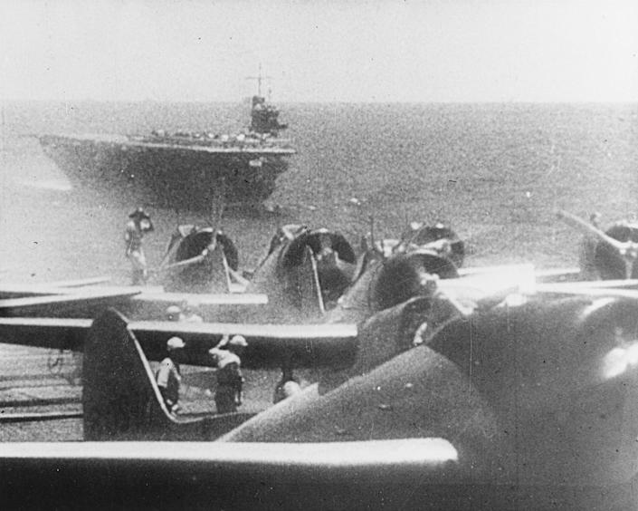 <p>Japanese Navy Type 99 Val carrier bombers prepare to take off from an aircraft carrier to attack Pearl Harbor on Dec. 7, 1941. The ship in the background is the carrier Soryu. (U.S. Navy/National Archives/Handout via Reuters) </p>