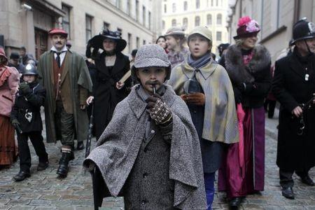 People dress up as characters from Arthur Conan Doyle's stories as they celebrate the birthday of detective Sherlock Holmes in Riga