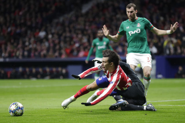 Lokomotiv's goalkeeper Anton Kochenkov fouls Atletico Madrid's Joao Felix during the Champions League Group D soccer match between Atletico Madrid and Lokomotiv Moscow at Wanda Metropolitano stadium in Madrid, Spain, Wednesday, Dec. 11, 2019. (AP Photo/Manu Fernandez)