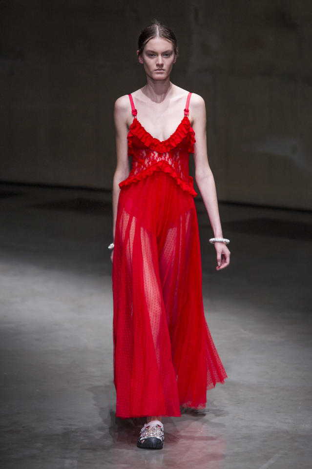 <p><i>Bold red semi-sheer ruffle bodice dress from the SS18 Christopher Kane collection. (Photo: IMAXtree) </i></p>