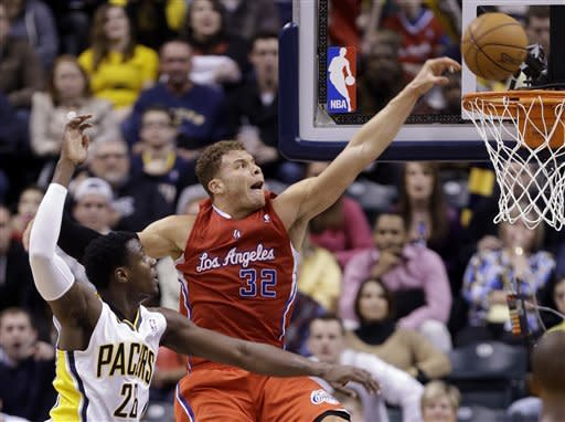 Los Angeles Clippers forward Blake Griffin, right, gets a dunk behind Indiana Pacers center Ian Mahinmi during the second half of an NBA basketball game in Indianapolis, Thursday, Feb. 28, 2013. The Clippers defeated the Pacers 99-91. (AP Photo/Michael Conroy)