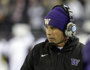 Washington head coach Chris Petersen watches from the sidline in the first half of an NCAA college football game against Washington State, Saturday, Nov. 29, 2014, in Pullman, Wash. (AP Photo/Ted S. Warren)