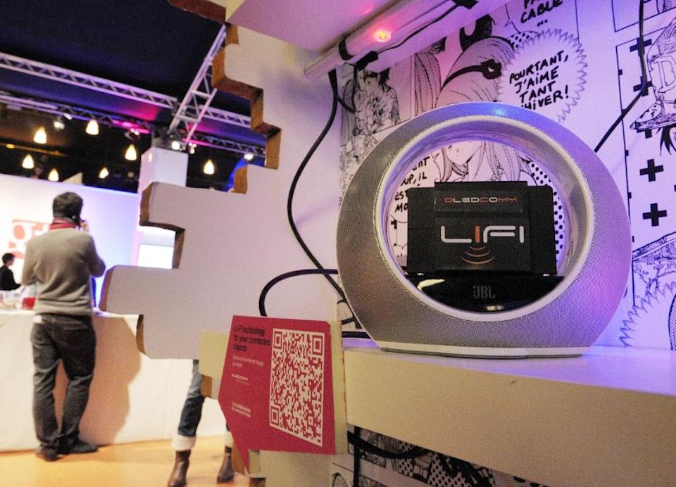 French start-up Oledcomm has unveiled its Li-Fi technology system -- which uses light to connect users to the Internet (AFP Photo/Eric Piermont)