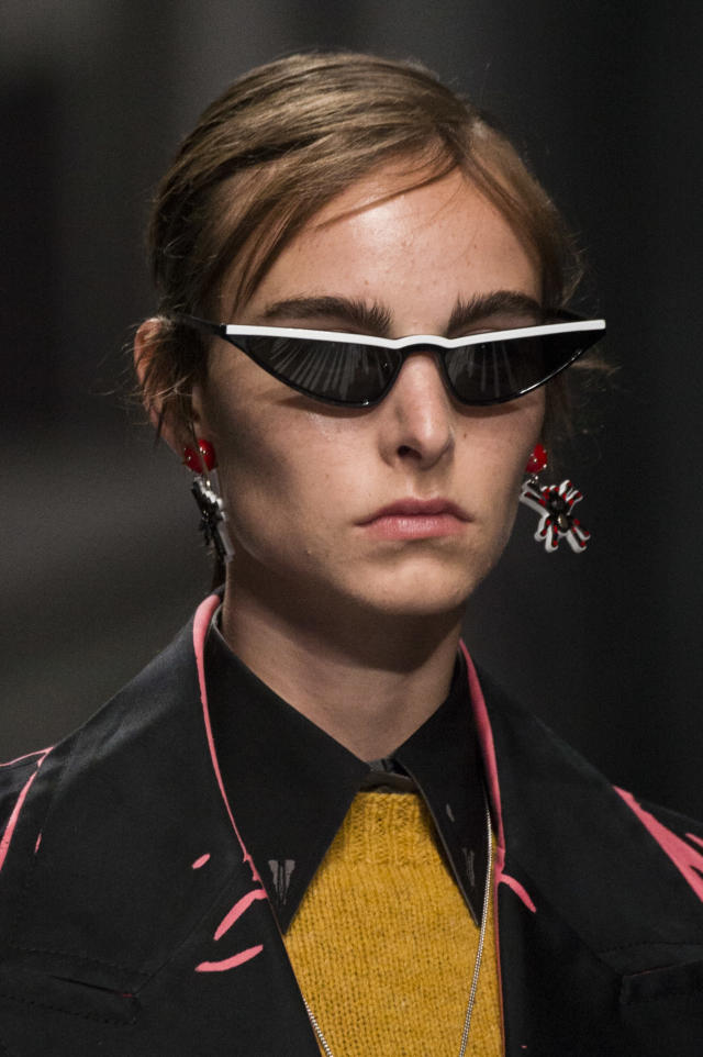<p><i>White striped <em>Matrix</em>-style sunglasses from the SS18 Prada collection. (Photo: ImaxTree) </i></p>