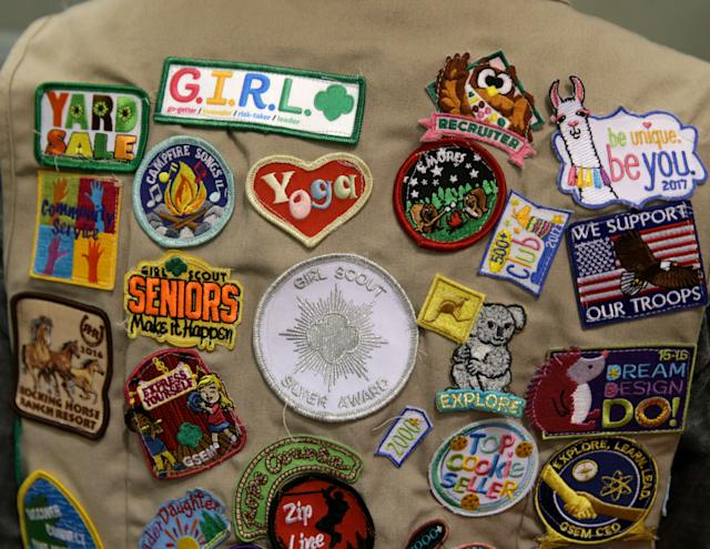 A collection of Girl Scout badges. (Photo: Jonathan Wiggs\Boston Globe)