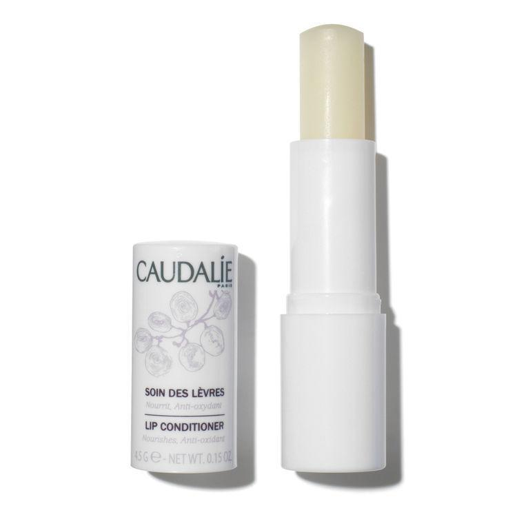 """<h3>Caudalie Lip Conditioner</h3><br>In the same way you look for active ingredients for your serums and moisturizers, look for them in your lip care, too. This one from Caudalie has enough active ingredients, antioxidants, and oils to practically be a skin-care treatment in and of itself.<br><br><strong>Caudalie</strong> Lip Conditioner, $, available at <a href=""""https://go.skimresources.com/?id=30283X879131&url=https%3A%2F%2Fwww.sephora.com%2Fproduct%2Flip-conditioner-P6034%3Fom_mmc%253Appc-GG_1533944608_60212794284_297728695824_241653_291191670138_9067609_c%2Ccountry_switch%3Aus%2Clang%3Aen%26ds_rl%3D1261471%26gclid%3DCj0KCQiAmuHhBRD0ARIsAFWyPwg_0YWo_m-t9iCgMy7rvsqfq-wJrvtI4P0jRaFQj-C0a65wq3rszCQaAliAEALw_wcB%26gclsrc%3Daw.ds"""" rel=""""nofollow noopener"""" target=""""_blank"""" data-ylk=""""slk:Sephora"""" class=""""link rapid-noclick-resp"""">Sephora</a>"""
