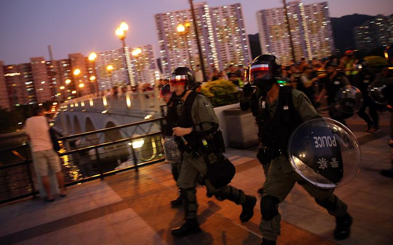 Riot police on the move in Sha Tin in Hong Kong, China - REX