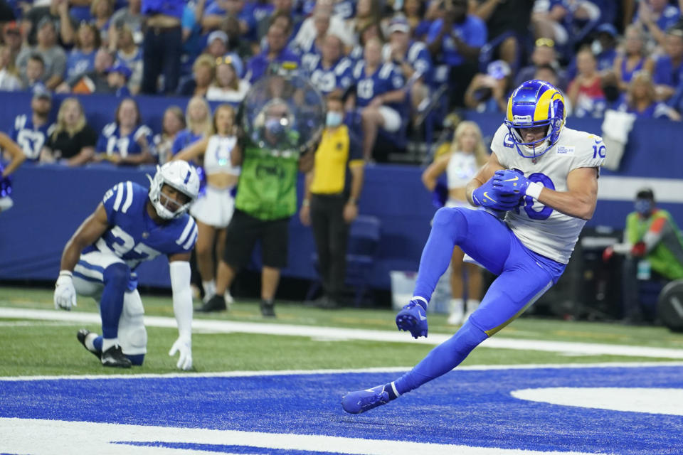 Los Angeles Rams' Cooper Kupp (10) makes a touchdown reception during the first half of an NFL football game against the Indianapolis Colts, Sunday, Sept. 19, 2021, in Indianapolis. (AP Photo/Michael Conroy)