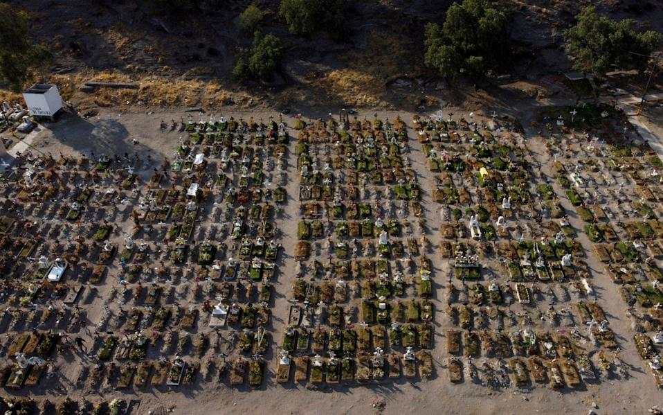 Graves are seen at the Xico cemetery, as the coronavirus outbreak continues, in Valle de Chalco, in the State of Mexico - Reuters