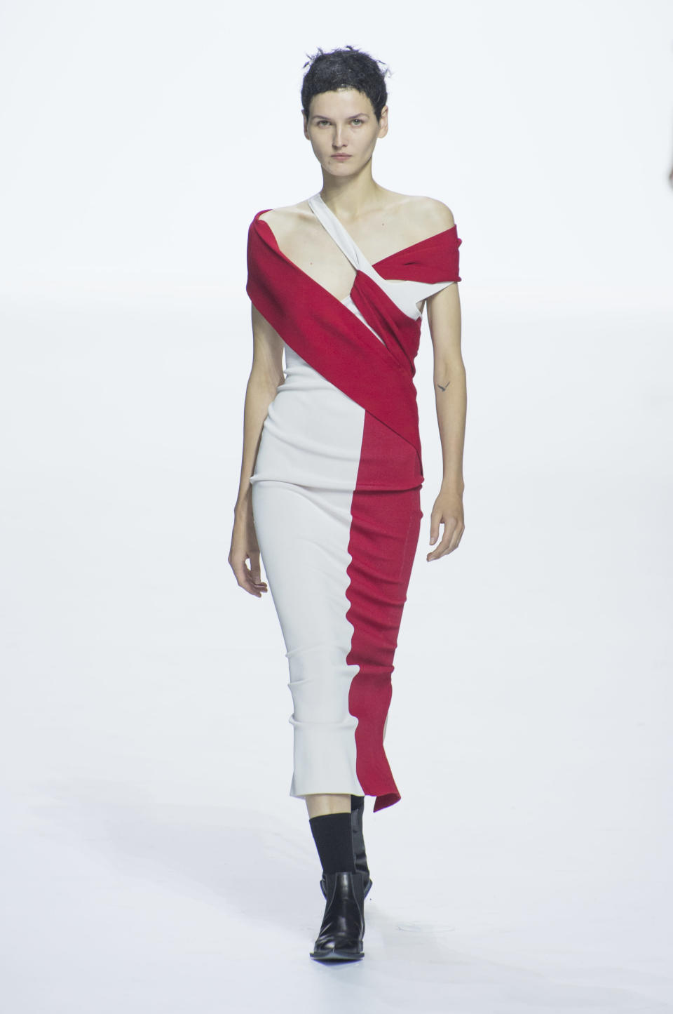 <p><i>Red and white open shoulder fitted dress from the SS18 Haider Ackermann collection. (Photo: ImaxTree) </i></p>