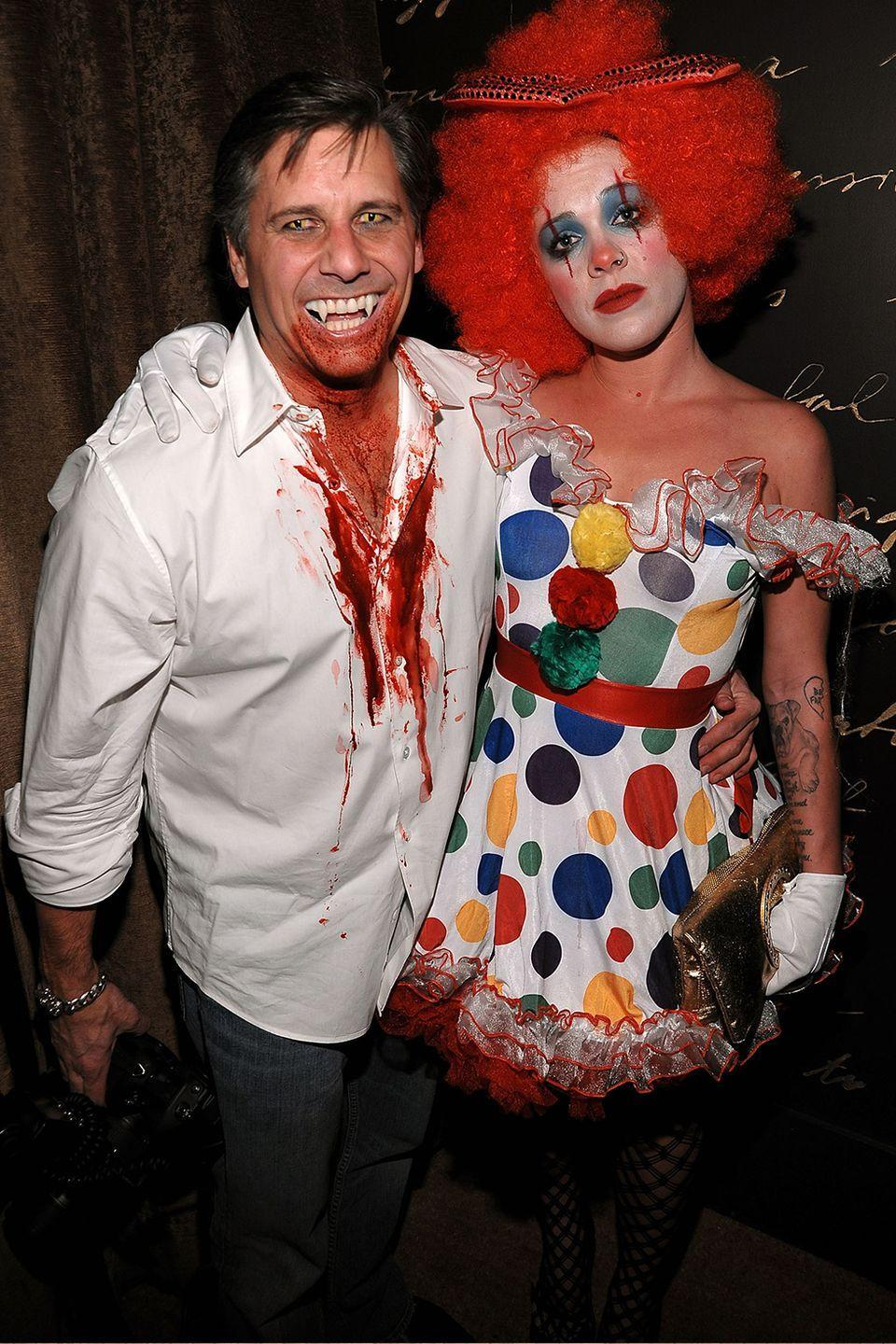 <p>Photographer Kevin Mazur and P!nk attended Heidi Klum's 2010 party as a creepy clown and vampire duo. I'm not quite sure how they go together, aside from the fact that the vamp could have drained the color from his clown's face.</p>