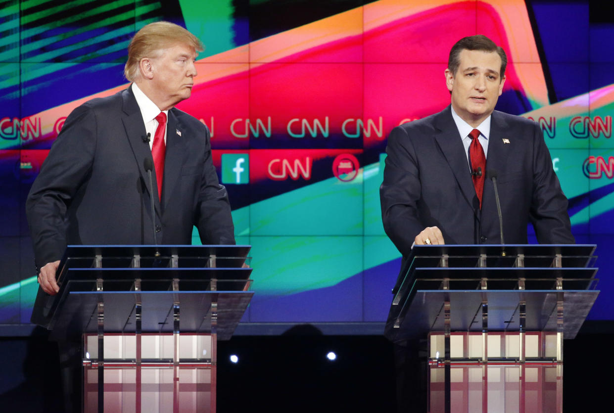 Sen. Ted Cruz speaks as Donald Trump listens during the CNN Republican presidential debate on Dec. 15, 2015, in Las Vegas. (Photo: John Locher/AP)