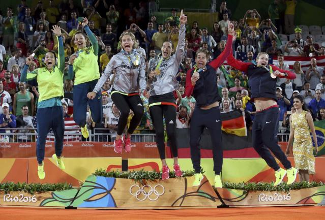 2016 Rio Olympics - Beach Volleyball - Women's Victory Ceremony - Beach Volleyball Arena - Rio de Janeiro, Brazil - 18/08/2016. Silver medalists Agatha Bednarczuk (BRA) of Brazil and Barbara Seixas Figueiredo (BRA) of Brazil, gold medalists Laura Ludwig (GER) of Germany and Kira Walkenhorst (GER) of Germany, and bronze medalists April Ross (USA) of USA and Kerri Walsh (USA) of USA celebrate. REUTERS/Adrees Latif TPX IMAGES OF THE DAY. FOR EDITORIAL USE ONLY. NOT FOR SALE FOR MARKETING OR ADVERTISING CAMPAIGNS.