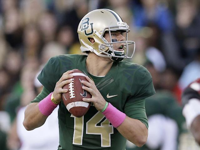 FILE - In this Oct. 19, 2013 file photo, Baylor quarterback Bryce Petty prepares to pass against Iowa State during an NCAA college football game in Waco, Texas. No. 5 Baylor takes on No. 12 Oklahoma in Waco on Thursday, Nov. 7, 2013. (AP Photo/Tony Gutierrez, File)