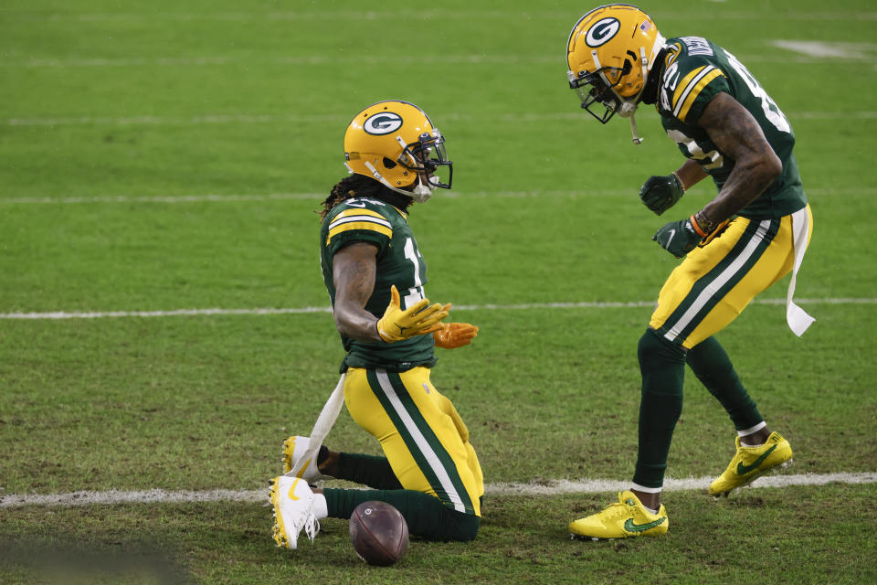 Green Bay Packers' Davante Adams, left, celebrates after scoring with Marquez Valdes-Scantling after a touchdown during the first half of an NFL divisional playoff football game against the Los Angeles Rams, Saturday, Jan. 16, 2021, in Green Bay, Wis. (AP Photo/Matt Ludtke)