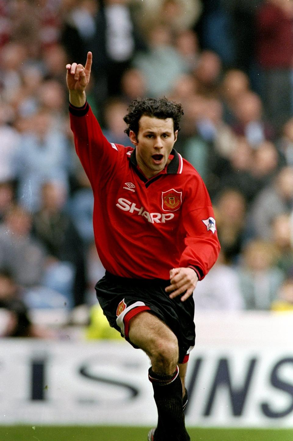 Ryan Giggs of Manchester United celebrates during an FA Carling Premiership match against Manchester City at Maine Road.