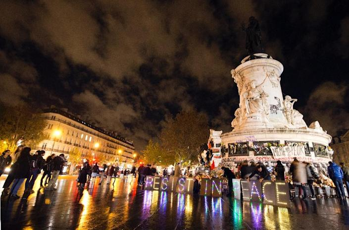 People gather at the Place de la Republique square on November 17, 2015 in Paris, to pay tribute to victims of the attacks (AFP Photo/Joel Saget)