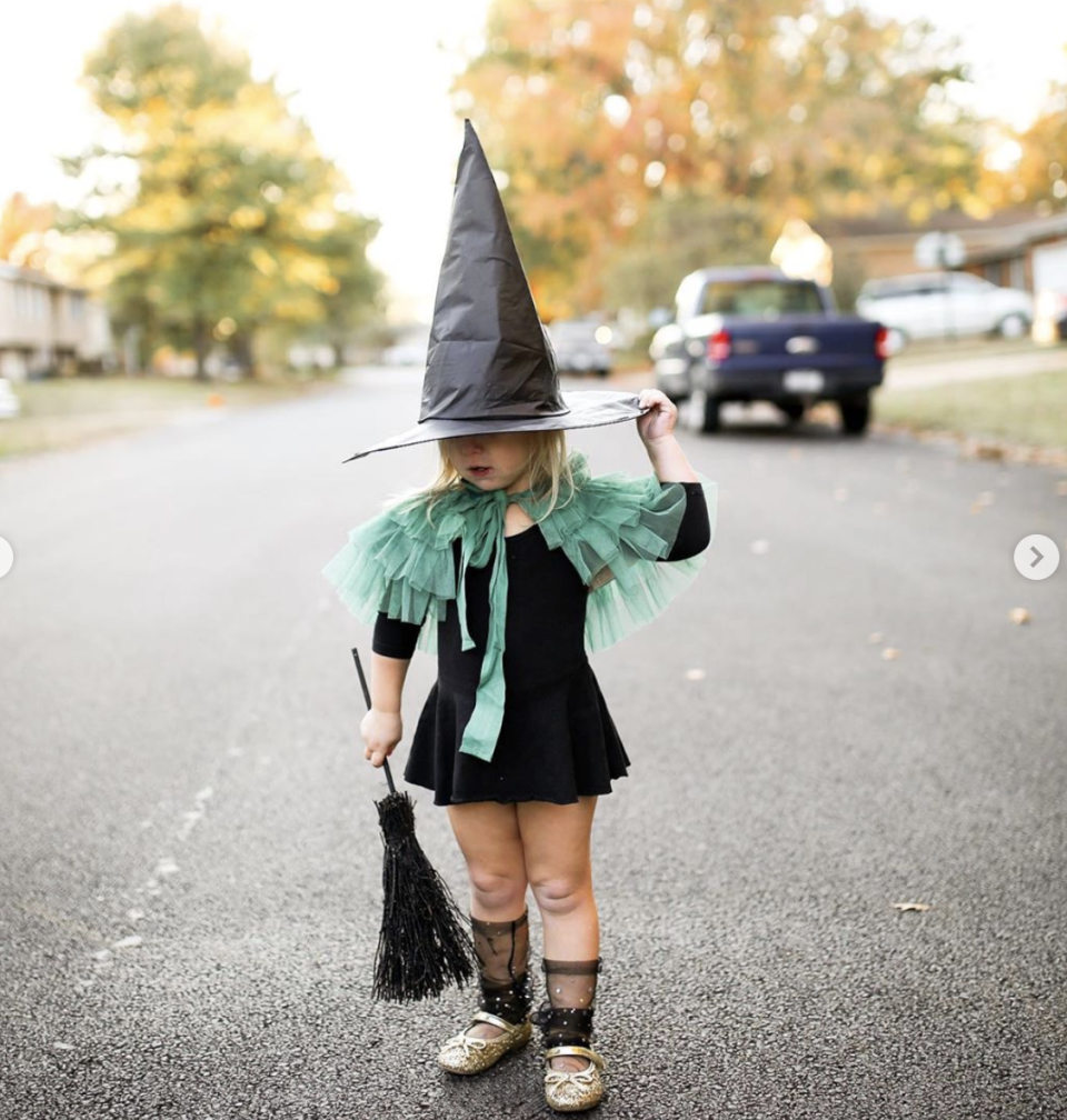 """<p>This sweet witch getup suits both toddlers and adults alike. It's easy to pull off, too. Slip on a black dress, then accessorize to your heart's content. Take inspiration from this look, which adds a green tutu cape, gold Mary Janes, sheer knee highs, a broom, and a witch hat. </p><p><a class=""""link rapid-noclick-resp"""" href=""""https://www.amazon.com/Arshiner-Girls-Sleeve-Skater-Summer/dp/B07JLBLHKT/?tag=syn-yahoo-20&ascsubtag=%5Bartid%7C10072.g.33534666%5Bsrc%7Cyahoo-us"""" rel=""""nofollow noopener"""" target=""""_blank"""" data-ylk=""""slk:SHOP BLACK DRESS"""">SHOP BLACK DRESS</a></p><p><a class=""""link rapid-noclick-resp"""" href=""""https://www.amazon.com/dp/B08965FCX9/?tag=syn-yahoo-20&ascsubtag=%5Bartid%7C10072.g.33534666%5Bsrc%7Cyahoo-us"""" rel=""""nofollow noopener"""" target=""""_blank"""" data-ylk=""""slk:SHOP CAPE"""">SHOP CAPE</a></p><p><a class=""""link rapid-noclick-resp"""" href=""""https://www.amazon.com/Thee-Bron-Zapatos-peque%C3%B1a-zapatos/dp/B07KT2Q4HJ?tag=syn-yahoo-20&ascsubtag=%5Bartid%7C10072.g.33534666%5Bsrc%7Cyahoo-us"""" rel=""""nofollow noopener"""" target=""""_blank"""" data-ylk=""""slk:SHOP MARY JANES"""">SHOP MARY JANES</a></p><p><a class=""""link rapid-noclick-resp"""" href=""""https://www.amazon.com/Accueil-Halloween-Witches-Plastic-Decoration/dp/B07XLTNNDP?tag=syn-yahoo-20&ascsubtag=%5Bartid%7C10072.g.33534666%5Bsrc%7Cyahoo-us"""" rel=""""nofollow noopener"""" target=""""_blank"""" data-ylk=""""slk:SHOP HAT AND BROOM SET"""">SHOP HAT AND BROOM SET</a></p>"""