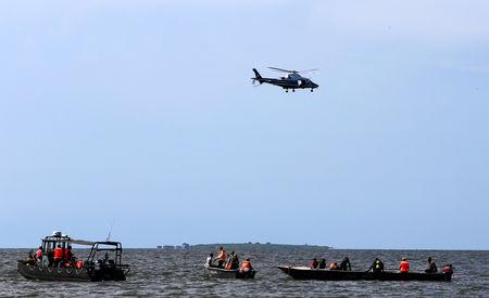 Rescue and recovery missions search for the bodies of dead passengers after a cruise boat capsized in Lake Victoria off Mukono district, Uganda November 25, 2018. REUTERS/James Akena