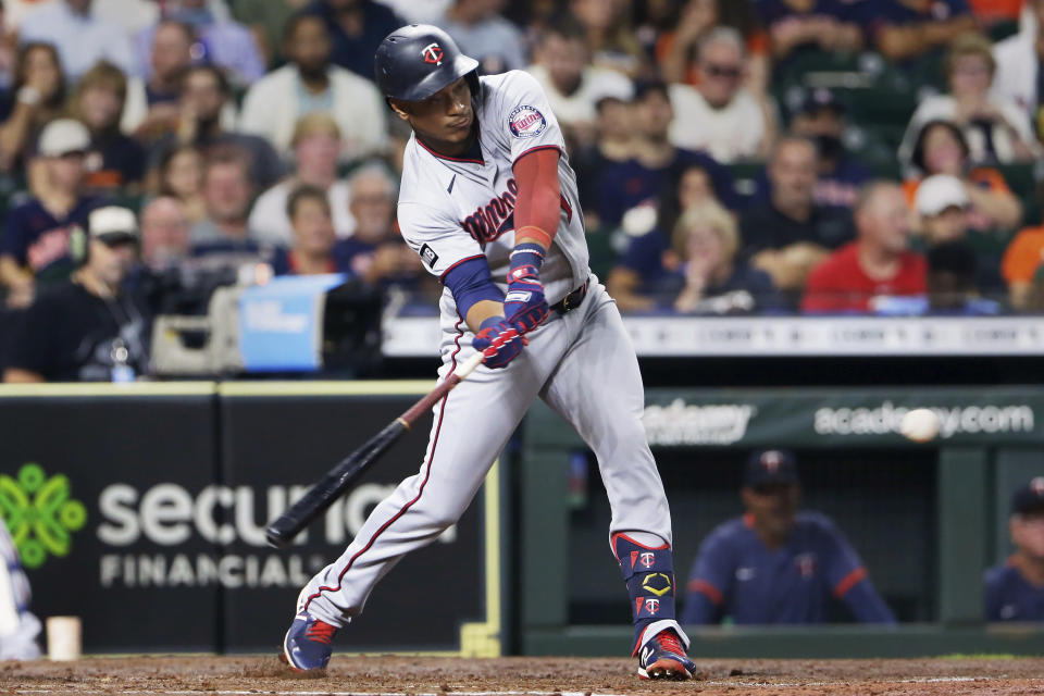 Minnesota Twins' Jorge Polanco hits an RBI single during the second inning of the team's baseball game against the Houston Astros on Thursday, Aug. 5, 2021, in Houston. (AP Photo/Michael Wyke)