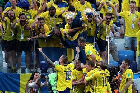 Soccer Football - World Cup - Group F - Sweden vs South Korea - Nizhny Novgorod Stadium, Nizhny Novgorod, Russia - June 18, 2018 Sweden's Andreas Granqvist celebrates scoring their first goal in front of fans with team mates REUTERS/Ivan Alvarado TPX IMAGES OF THE DAY