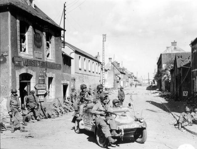 <p>U.S. Army paratroopers of the 101st Airborne Division drive a captured German Kübelwagen on D-Day at the junction of Rue Holgate and RN13 in Carentan, France, on June 6, 1944. (Photo: U.S. National Archives/handout via Reuters) </p>