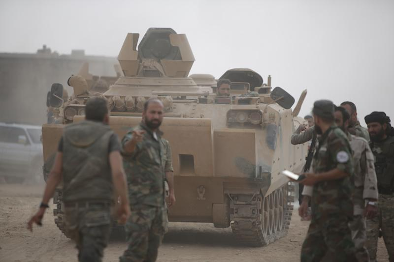 TAL ABYAD, SYRIA - OCTOBER 16: Syrian National Army members patrol an area with a tank in Tal Abyad, which of its city center was cleared from PKK, listed as a terrorist organization by Turkey, the U.S. and the EU, and Syrian Kurdish YPG militia, which Turkey regards as a terror group, within Turkey's Operation Peace Spring in northern Syria, in Tal Abyad, Syria on October 16, 2019. The operation is ongoing in the countryside of Tal Abyad. (Photo by Bekir Kasim/Anadolu Agency via Getty Images)