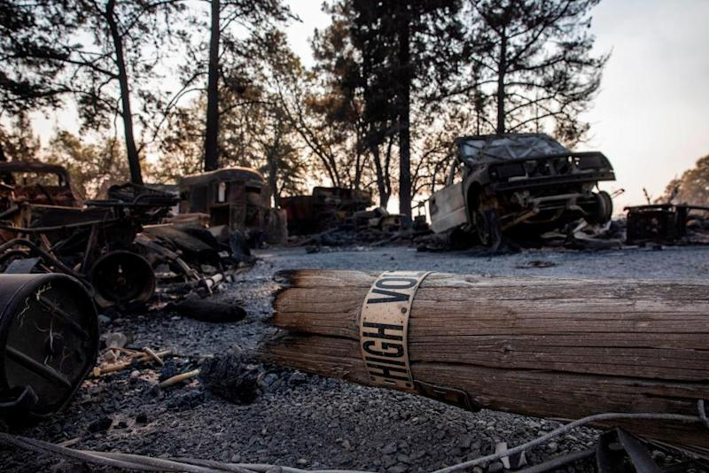 A fallen PG&E utility pole lays on a property burned during the Kincade Fire.