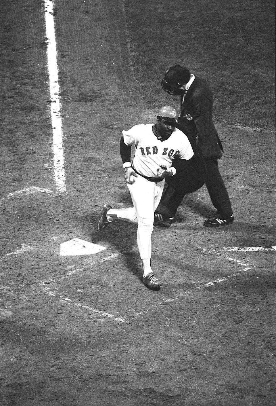 George Scott crosses the plate after hitting a home run in 1977.