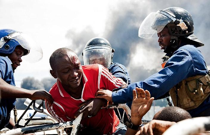 A man is lifted by police during a protest in Bujumbura on May 13, 2015 (AFP Photo/Landry Nshimiye)